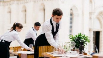 Waiter setting up the table